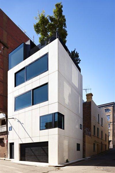 fachada de casas pequenas e modernas - construção em blocos